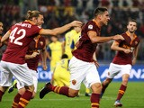 Roma's Marco Borriello celebrates with his teammates after scoring the opening goal during the Serie A match against Chievo Verona on October 31, 2013
