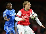Nicklas Bendtner of Arsenal beats Michael Essien of Chelsea to the ball during the Capital One Cup Fourth Round match on October 29, 2013