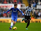 Chelsea's Oscar and Newcastle's Cheik Tiote in action during their Premier League match on November 2, 2013