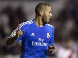 Real Madrid's French forward Karim Benzema celebrates after scoring during the Spanish league football match Rayo Vallecano vs Real Madrid at the Vallecas stadium in Madrid on November 2, 2013