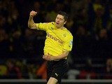 Dortmund's Robert Lewandowski celebrates after scoring his team's third goal against Stuttgart on November 1, 2013