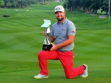 Ryan Moore of USA poses with the CIMB Classic Trophy after he won it in a playoff with Gary Woodland of USA during the playoff during the CIMB Classic at Kuala Lumpur Golf & Country Club on October 28, 2013