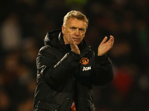 Manager David Moyes of Manchester United applauds the travellling fans at the final whislte during the Barclays Premier League match between Fulham and Manchester United at Craven Cottage on November 2, 2013