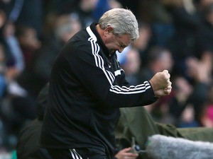 Hull manager Steve Bruce celebrates the own goal of Carlos Cuellar of Sunderland during the Barclays Premier League match between Hull City and Sunderland at KC Stadium on November 2, 2013
