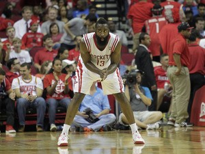 James Harden #13 of the Houston Rockets watches from the end of the court during a free throw opportunity against the Dallas Mavericks at Toyota Center on November 1, 2013