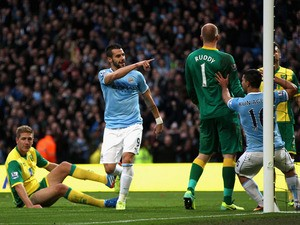 Alvaro Negredo of Manchester City celebrates scoring the fourth goal during the Barclays Premier League match between Manchester City and Norwich City at Etihad Stadium on November 2, 2013