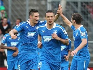 Hoffenheim's Niklas Suele celebrates with teammates after scoring the opening goal against Bayern Munich on November 2, 2013