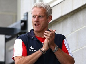 Coach of Lancashire Peter Moores applauds his players after the LV County Championship Division Two match between Gloucestershire and Lancashire on September 20, 2013