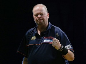 Raymond van Barneveld of the Netherlands celebrates winning a leg in his first round match against Clinton Bridge of Australia during the Sydney Darts Masters at Luna Park on August 29, 2013