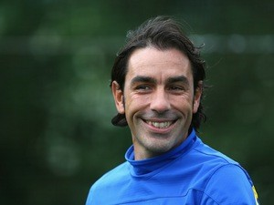 Robert Pires looks on during an Arsenal training session at London Colney on September 30, 2013