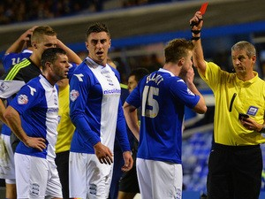 Referee Simon Hooper shows Wade Elliott of Birmingham City a red card during the Capital One Cup Fourth Round match against Stoke City on October 29, 2013