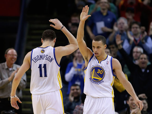Stephen Curry #30 of the Golden State Warriors is congratulated by Klay Thompson #11 after Curry made a basket and was fouled during their game against the Oklahoma City Thunder at Oracle Arena on January 23, 2013