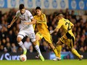 Erik Lamela of Spurs is closed down by Luvannor Henrique and Kobi Moyal of FC Sheriff during the UEFA Europa League Group K match on November 7, 2013