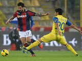 Panagiotis Kone # 33 of Bologna FC competes the ball with Marcelo Estigarribia # 20 of AC Chievo Verona during the Serie A match between Bologna FC and AC Chievo Verona at Stadio Renato Dall'Ara on November 4, 2013