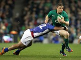 Ireland's centre Brian O'Driscoll is tackled by Samoa's centre Johnny Leota during the International rugby union test match between Ireland and Samoa on November 9, 2013