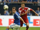 Schalke's Austrian defender Christian Fuchs and Hamburg's defender Dennis Diekmeier vie for the ball during the German first division Bundesliga football match FC Schalke 04 vs Hamburger SV in the German city of Gelsenkirchen on August 11, 2013