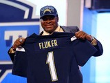 D.J. Fluker of the Alabama Crimson Tide holds up a jersey on stage after he was picked #11 overall by the San Diego Chargers in the first round of the 2013 NFL Draft at Radio City Music Hall on April 25, 2013
