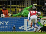 Arsenal's Welsh midfielder Aaron Ramsey scores past Dortmund's goalkeeper Roman Weidenfeller and Dortmund's Serbian defender Neven Subotic during the UEFA Champions League group F football match Borussia Dortmund vs Arsenal London in Dortmund, western Ger