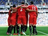 Sevilla's Federico Fazio is congratulated by teammates after scoring the opening goal against Espanyol on November 10, 2013