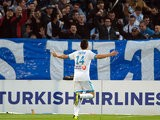 Marseille's Florian Thauvin celebrates after scoring the opening goal against Sochaux on November 10, 2013