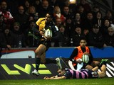 Ken Pisi of Northampton Saints runs through a tackle on his way to scoring his second try during the LV= Cup match between Northampton Saints and Gloucester at Franklin's Gardens on November 9, 2013