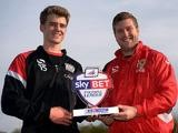 MK Dons striker Patrick Bamford with his manager Karl Robinson and his Player of the Month award for October on November 7, 2013