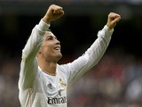 Real Madrid's Portuguese forward Cristiano Ronaldo celebrates after scoring his third goal during the Spanish league football match Real Madrid vs Real Sociedad at the Santiago Bernabeu stadium in Madrid on November 9, 2013