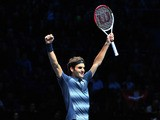 Switzerland's Roger Federer celebrates beating Argentina's Juan Martin Del Potro during their group B singles match in the round robin stage on the sixth day of the ATP World Tour Finals tennis tournament in London on November 9, 2013