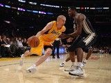 Steve Blake #5 of the Los Angeles Lakers drives to the basket around Derrick Favors #15 of the Utah Jazz in the second half at Staples Center on October 22, 2013