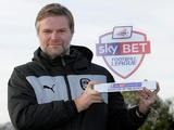 Coventry City manager Steven Pressley celebrates his Manager of the Month award for October on November 7, 2013