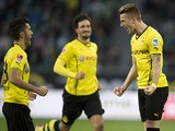 Dortmund's Marco Reus celebrates scoring the opening goal during German first division Bundesliga football match VfL Wolfsburg vs Borussia Dortmund at the Volkswagen arena in Wolfsburg on November 9, 2013