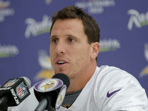 Linebacker Chad Greenway talks to members of the press during a Minnesota Vikings press conference at the Grove Hotel on September 26, 2013