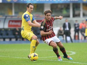 Chievo Verona's Dario Dainelli and AC Milan's Alessandro Matri battle for the ball on November 10, 2013