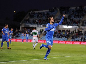 Pedro Leon of Getafe CF celebrates after scoring his team's first goal during the La Liga match between Getafe CF and Elche FC at Coliseum Alfonso Perez stadium on November 9, 2013