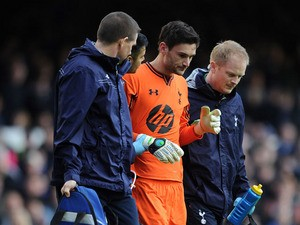 Hugo Lloris of Tottenham Hotspur leaves the field through injury during the Barclays Premier League match between Everton and Tottenham Hotspur at Goodison Park on November 03, 2013