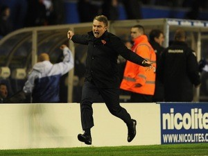 Birmingham City manager Lee Clark celebrates down the touchline during the League Cup match against Stoke City on October 29, 2013