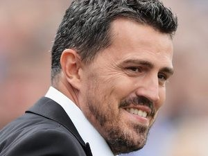 Brighton & Hove Albion manager Oscar Garcia attempts to break into a smile on August 10, 2013