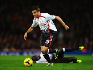Philippe Coutinho of Liverpool runs with the ball during the Barclays Premier League match between Arsenal and Liverpool at Emirates Stadium on November 2, 2013