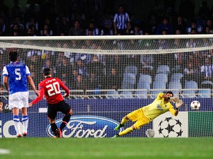 Robin van Persie of Manchester United fails to score from the penalty spot during the UEFA Champions League Group A match between Real Sociedad de Futbol and Manchester United at Estadio Anoeta on November 5, 2013