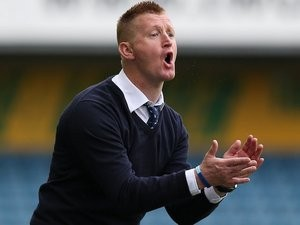 Millwall manager Steve Lomas encourages his side from the touchline on September 28, 2013
