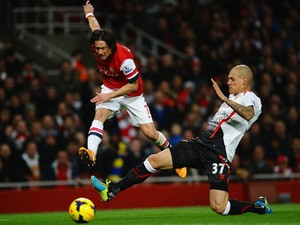 Martin Skrtel of Liverpool tackles Tomas Rosicky of Arsenal during the Barclays Premier League match between Arsenal and Liverpool at Emirates Stadium on November 2, 2013