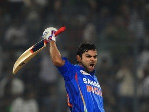 Indian batsman Virat Kholi reacts after scoring a century during the one day international Asia Cup cricket match between India and Pakistan on March 18, 2012