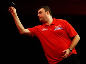 Wes Newton of England throws a dart during the quarter final match between Wes Newton of England and James Wade of England on day thirteen of the 2013 Ladbrokes.com World Darts Championship at Alexandra Palace on December 29, 2012