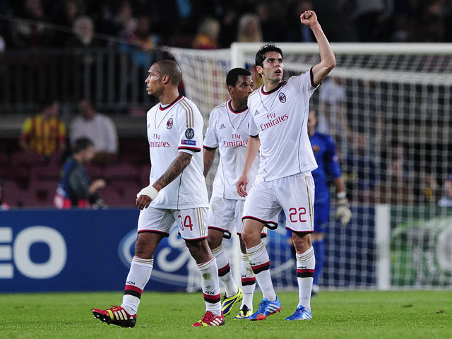 AC Milan's Brazilian forward Kaka celebrates his goal during the UEFA Champions league football match FC Barcelona vs AC Milan at the Camp Nou stadium in Barcelona on November 6, 2013