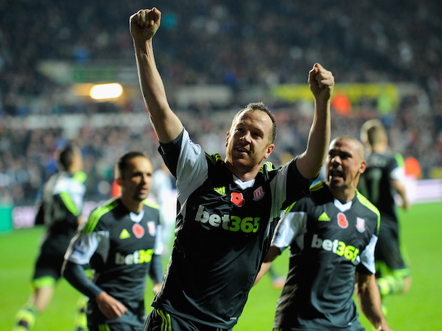 Stoke player Charlie Adam celebrates after scoring from the penalty spot to make the score 3-3 during the Barclays Premier League match against Swansea City on November 10, 2013