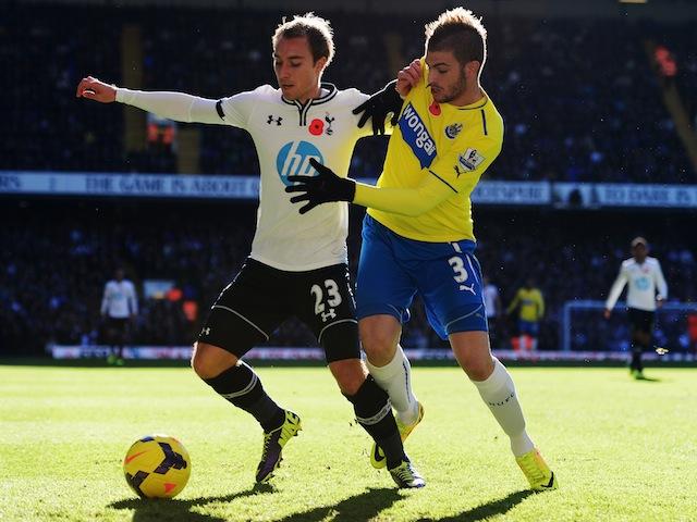 Tottenham Hotspur's Christian Eriksen and Davide Santon of Newcastle United battle for the ball at White Hart Lane on November 10, 2013
