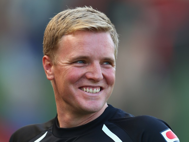 AFC Bournemouth manager Eddie Howe smiles during a pre-season friendly on July 13, 2013
