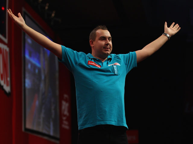 Kim Huybrechts of Belgium celebrates beating Paul Nicholson of England during Day 12 of the 2012 Ladbrokes.com World Darts Championship at Alexandra Palace on December 29, 2011