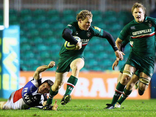Scott Hamilton of the Leicester Tigers breaks through the tackle of Tom Grabham of the Ospreys during the LV=Cup match between Leicester Tigers and Ospreys at Welford Road on November 8, 2013