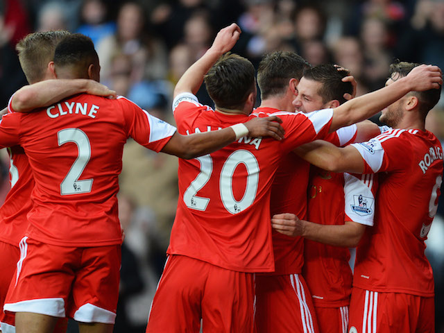 Morgan Schneiderlin of Southampton is congratulated by team mates as he scores their first goal during the Barclays Premier League match against Fulham on November 9, 2013